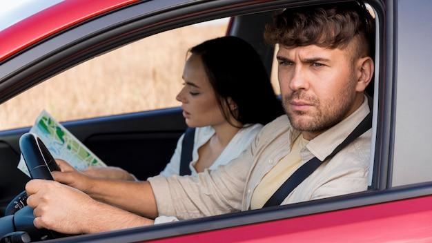 Medium shot frowning man driving