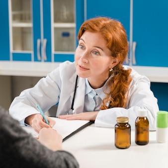 Medium shot ginger doctor and pills