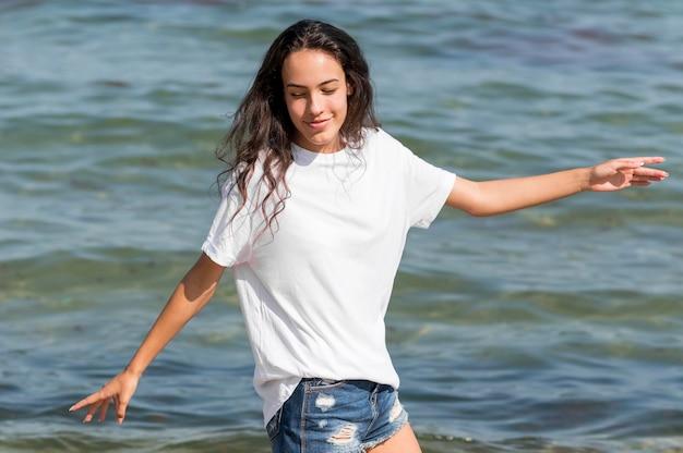 Medium shot of girl at beach