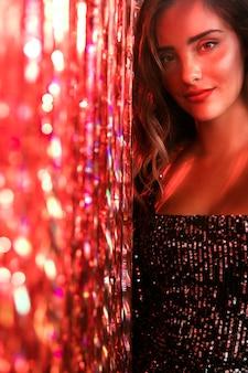 Medium shot of girl in a beautiful party dress