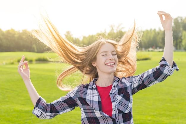 Medium shot girl being happy outside