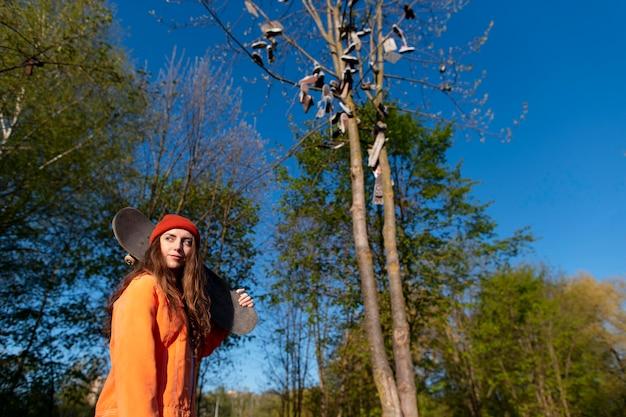 Medium shot girl carrying board