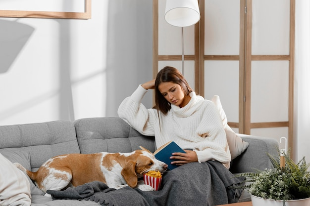 Medium shot girl on couch with dog