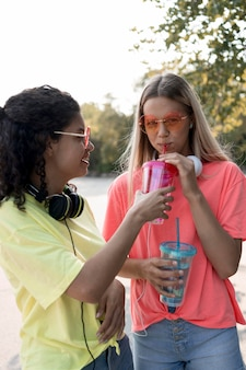 Medium shot girl drinking water