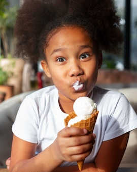 Medium shot girl eating ice cream