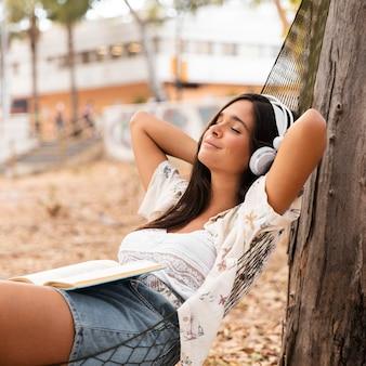 Medium shot girl laying in hammock