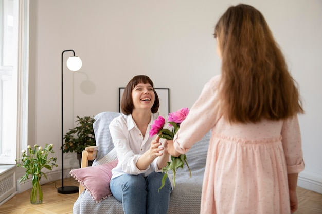 Medium shot girl offering flowers