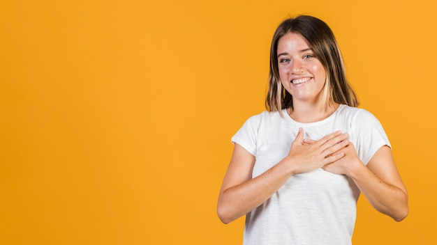 Medium shot girl with hands on her chest