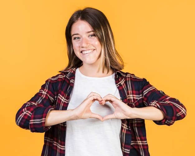 Medium shot girl with heart shaped hands