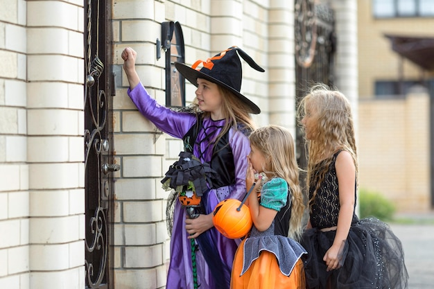 Medium shot of girl with trick or treat
