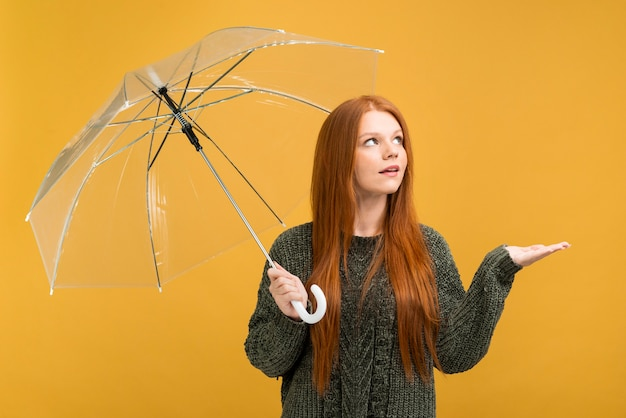 Medium shot girl with yellow background