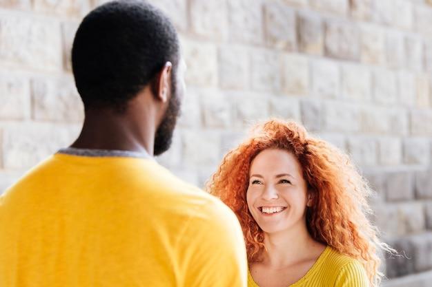 Medium shot of girlfriend smiling at boyfriend
