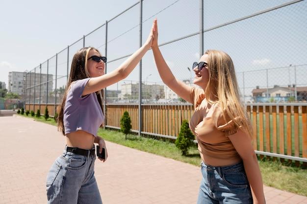 Medium shot girls high five