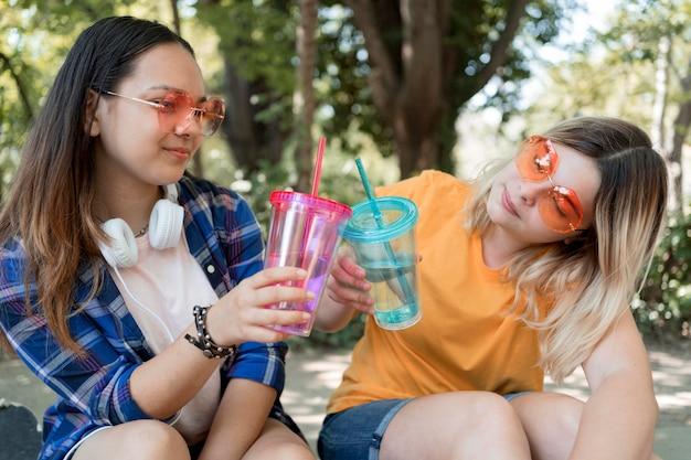 Medium shot girls with cups