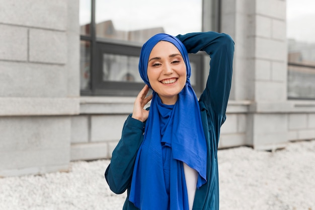 Medium shot gorgeous girl with hijab smiling