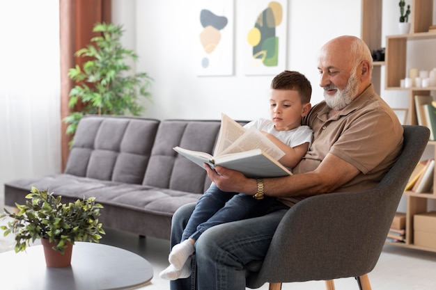 Medium shot grandfather reading to kid