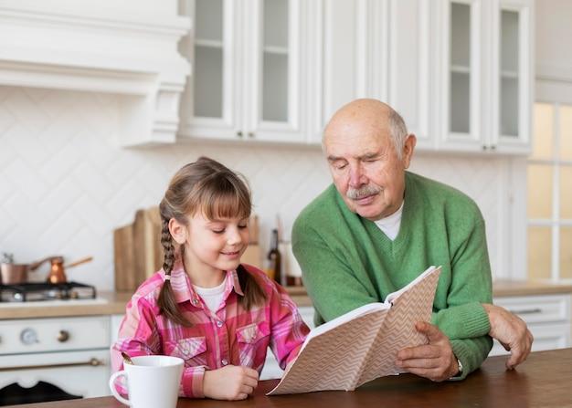 Medium shot grandpa and girl indoors
