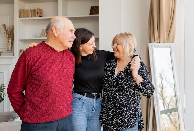Medium shot grandparents and woman