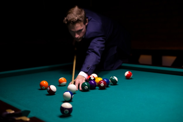 Medium shot guy in suit playing a game