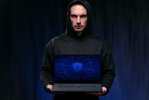 Medium shot hacker holding device