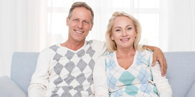 Medium shot happy couple posing together