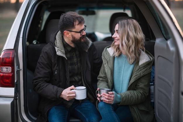 Medium shot happy couple in van
