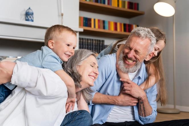 Medium shot happy family at home