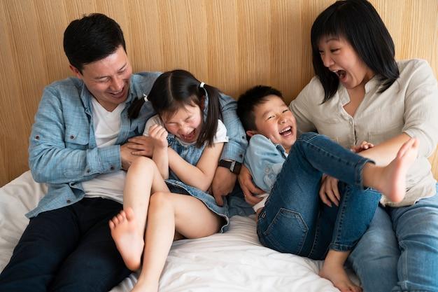 Medium shot happy family indoors