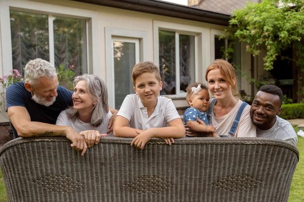 Medium shot happy family outdoors