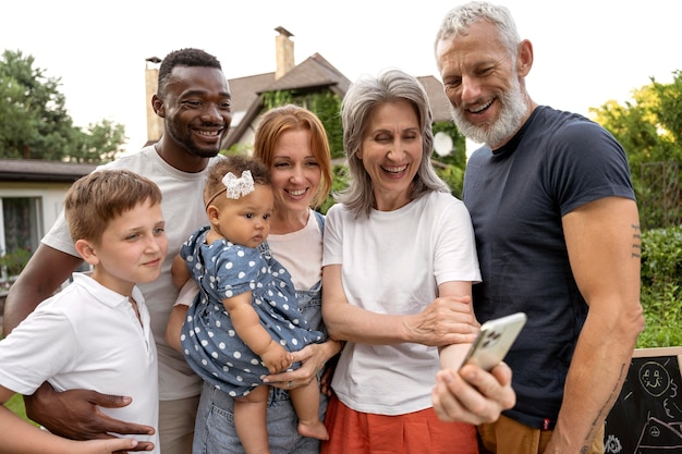Medium shot happy family taking selfie