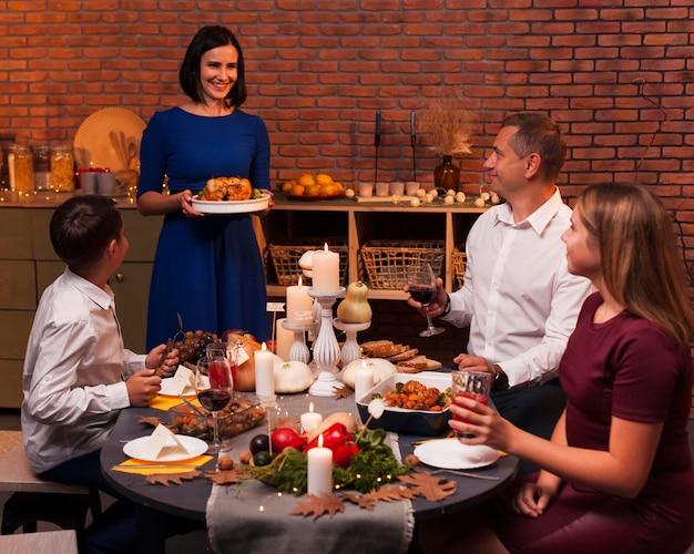 Medium shot happy family at thanksgiving