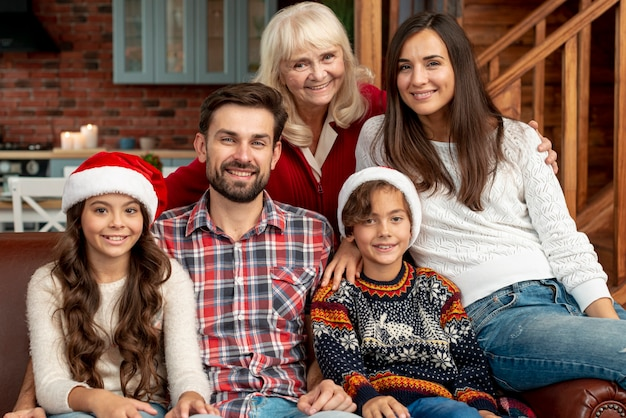 Medium shot happy family with grandmother