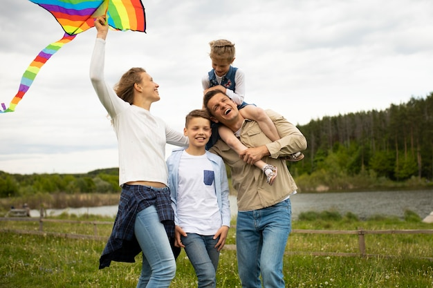 Medium shot happy family with kite