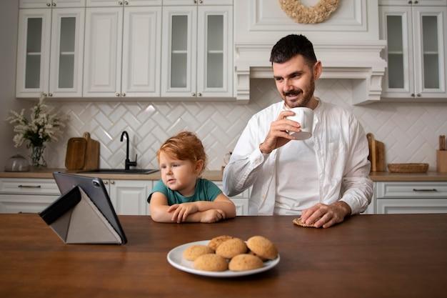 Medium shot happy father with kid