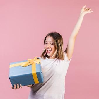 Medium shot happy girl holding a gift