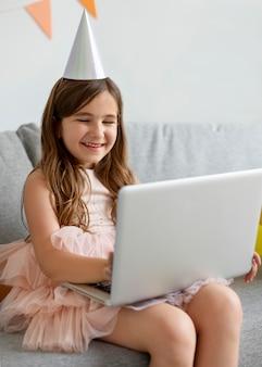 Medium shot happy girl holding laptop