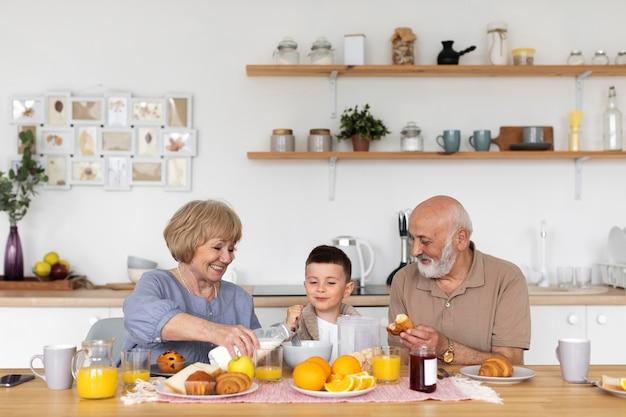 Medium shot happy grandparents and child