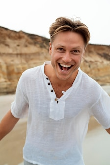 Medium shot happy man at beach