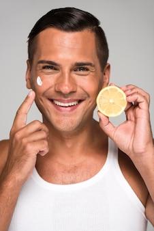 Medium shot happy man holding lemon
