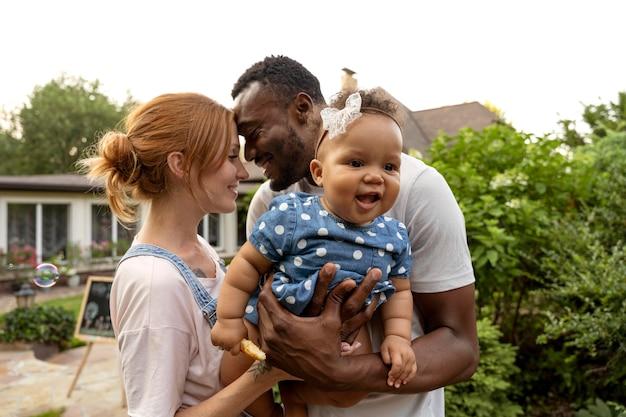 Medium shot happy parents with baby