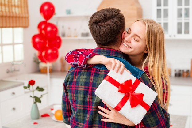 Medium shot happy woman hugging boyfriend