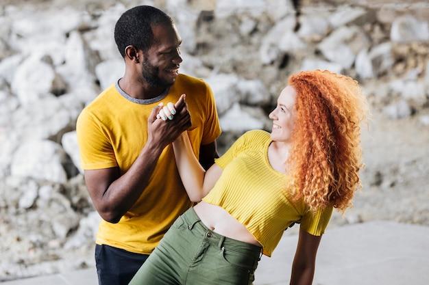 Medium shot of interracial couple having fun