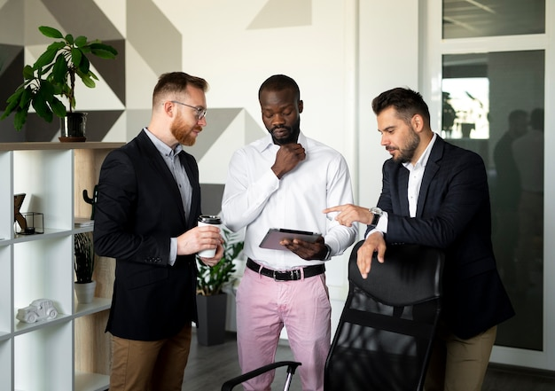 Medium shot of interracial employees