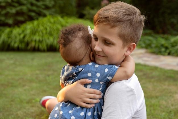 Medium shot kid holding baby