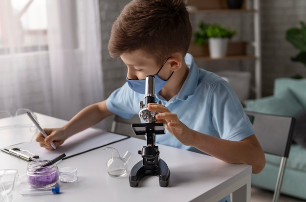 Medium shot kid learning with microscope