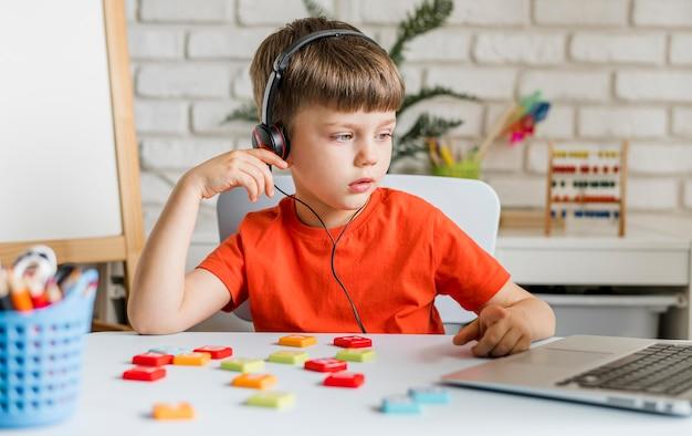 Medium shot kid wearing headphones