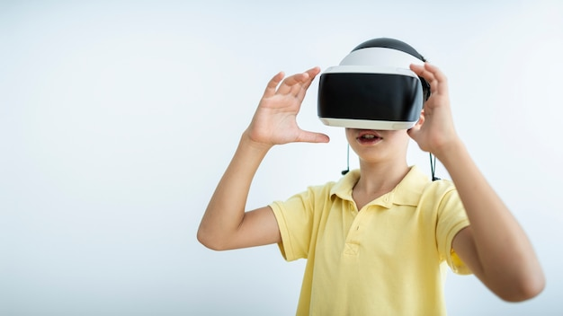 Medium shot kid wearing vr glasses