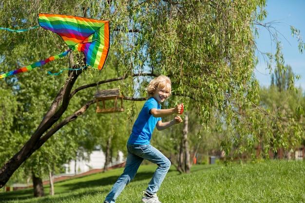 Medium shot kid with colorful kite