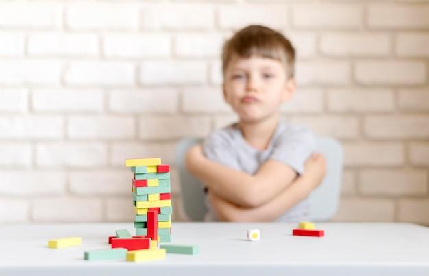 Medium shot kid with jenga game