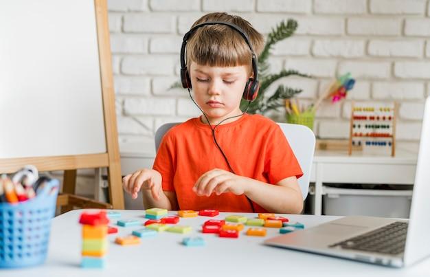 Medium shot kid with laptop
